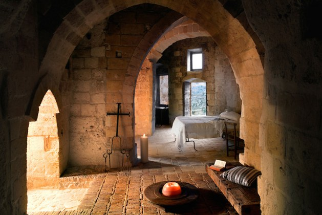 20 Astonishing Photos of Abandoned Italian Caves Turned Into Stunning Medieval Hotel Rooms. The Candle-Lit Cave Master Bedroom Suite Is Completely Breathtaking!